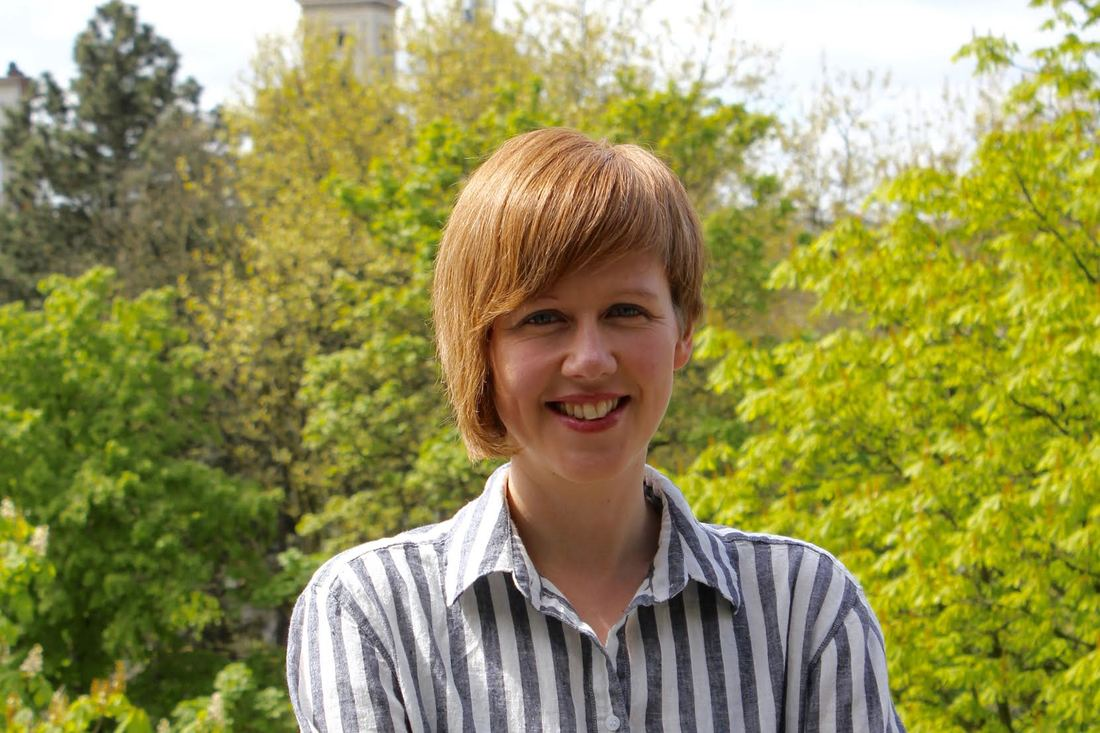 Portrait of Anna smiling in a park during Spring